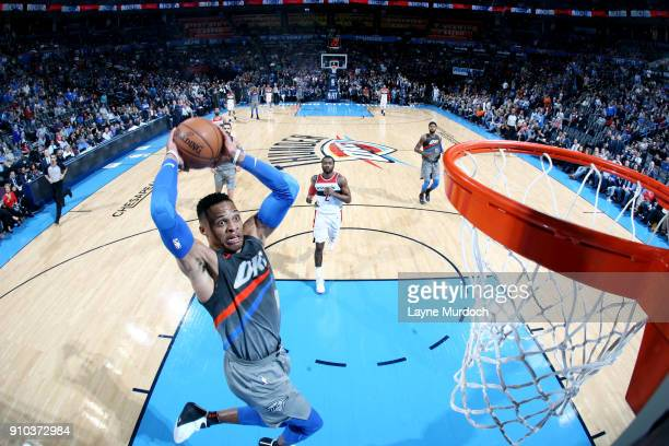 Russell Westbrook of the Oklahoma City Thunder dunks the ball during the game against the Washington Wizards on January 25 2018 at Chesapeake Energy...