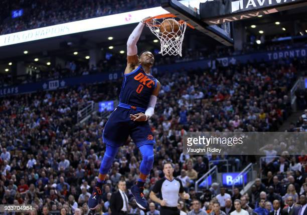 Russell Westbrook of the Oklahoma City Thunder dunks the ball during the first half of an NBA game against the Toronto Raptors at Air Canada Centre...