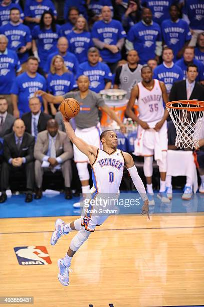 Russell Westbrook of the Oklahoma City Thunder dunks the ball in Game Three of the Western Conference Finals against the San Antonio Spurs during the...