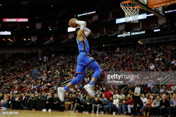 Russell Westbrook of the Oklahoma City Thunder dunks the ball in the second half against the Houston Rockets at Toyota Center on April 7 2018 in...