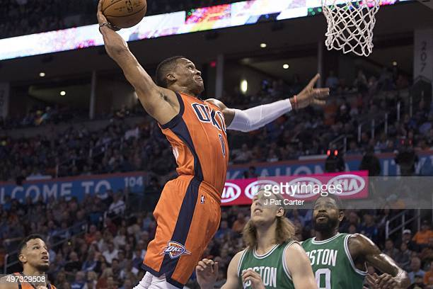 Russell Westbrook of the Oklahoma City Thunder dunks two points against the Boston Celtics during the first quarter of a NBA game at the Chesapeake...