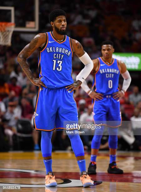 Russell Westbrook of the Oklahoma City Thunder during a break in action with Paul George during the game against the Miami Heat at American Airlines...