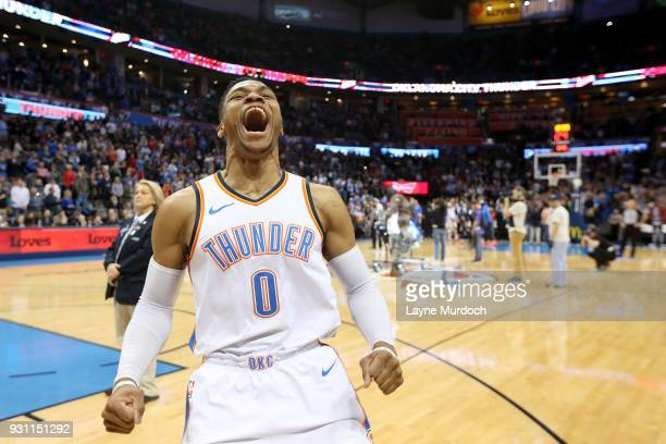 Russell Westbrook of the Oklahoma City Thunder excites the crowd before the game against the Sacramento Kings on March 12 2018 at Chesapeake Energy...