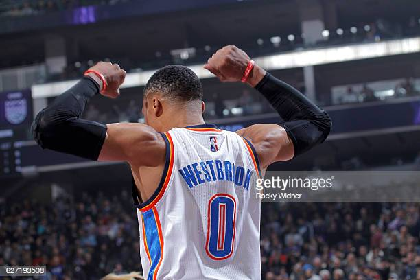 Russell Westbrook of the Oklahoma City Thunder flexes during the game against the Sacramento Kings on November 23 2016 at Golden 1 Center in...