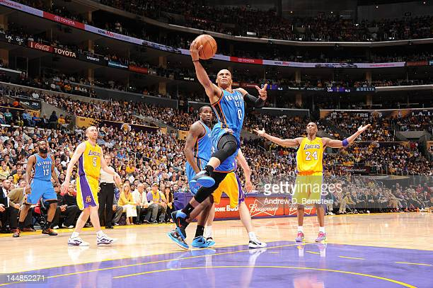Russell Westbrook of the Oklahoma City Thunder goes for a layup as Kobe Bryant of the Los Angeles Lakers reacts in Game Four of the Western...