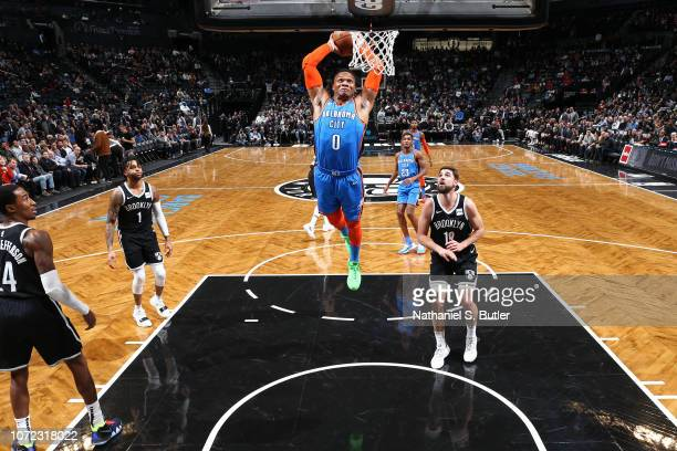 Russell Westbrook of the Oklahoma City Thunder goes for slam dunk against the Brooklyn Nets on December 5 2018 at Barclays Center in Brooklyn New...