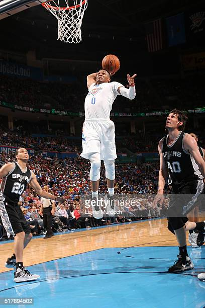 Russell Westbrook of the Oklahoma City Thunder goes for the dunk against the San Antonio Spurs during the game on March 26 2016 at Chesapeake Energy...
