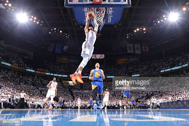 Russell Westbrook of the Oklahoma City Thunder goes for the dunk against the Golden State Warriors during Game Four of the Western Conference Finals...