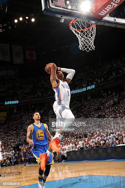Russell Westbrook of the Oklahoma City Thunder goes for the dunk during the game against the Golden State Warriors in Game Four of the Western...