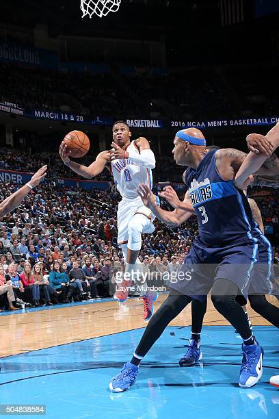 Russell Westbrook of the Oklahoma City Thunder goes for the layup during the game against the Dallas Mavericks on January 13 2016 at Chesapeake...