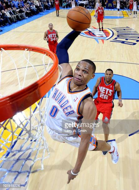 Russell Westbrook of the Oklahoma City Thunder goes in for a dunk against the New Jersey Nets during the game at the Oklahoma City Arena on December...