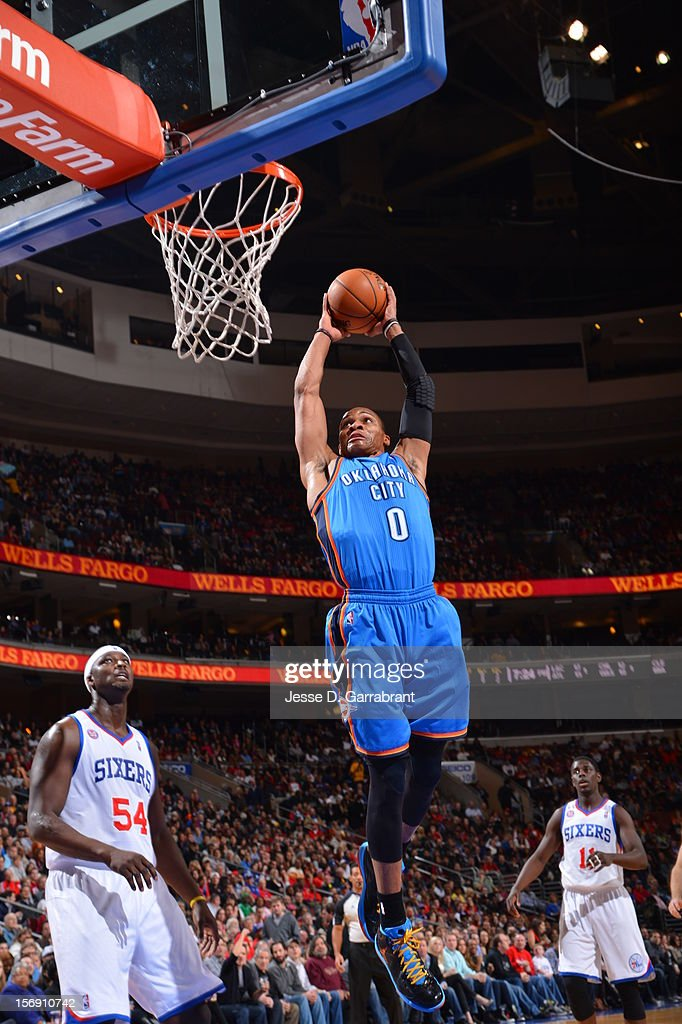 Russell Westbrook #0 of the Oklahoma City Thunder goes in for the dunk vs the Philadelphia 76ers during the game at the Wells Fargo Center on November 24, 2012 in Philadelphia, Pennsylvania.