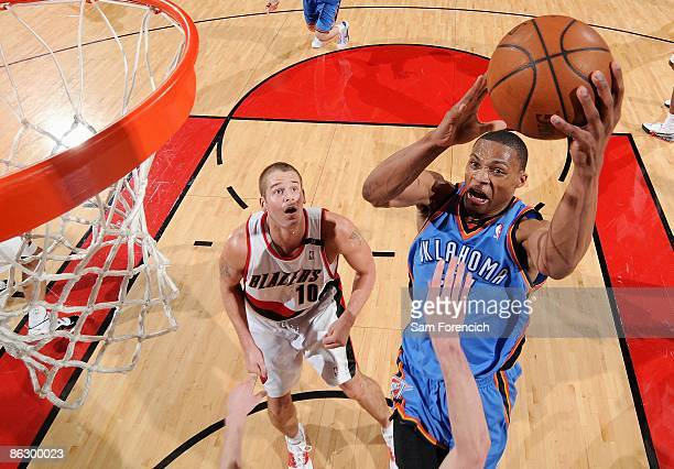 Russell Westbrook of the Oklahoma City Thunder goes to the basket as Joel Przybilla of the Portland Trail Blazers looks on during the game on April...