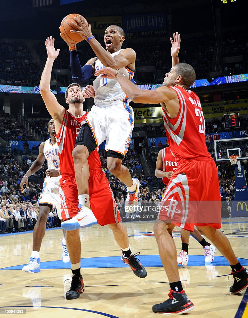 Russell Westbrook #0 of the Oklahoma City Thunder goes to the basket against Shane Battier #31 and Brad Miller #52 of the Houston Rockets during the game at the Oklahoma City Arena on November 17, 2010 in Oklahoma City, Oklahoma.