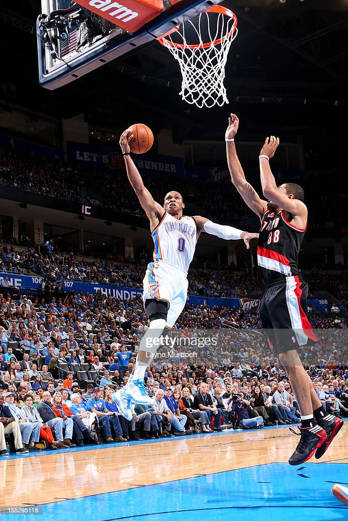 Russell Westbrook #0 of the Oklahoma City Thunder goes to the basket against Nicolas Batum #88 of the Portland Trail Blazers on November 2, 2012 at the Chesapeake Energy Arena in Oklahoma City, Oklahoma.
