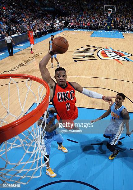 Russell Westbrook of the Oklahoma City Thunder goes to the basket against the Denver Nuggets on December 27 2015 at Chesapeake Energy Arena in...