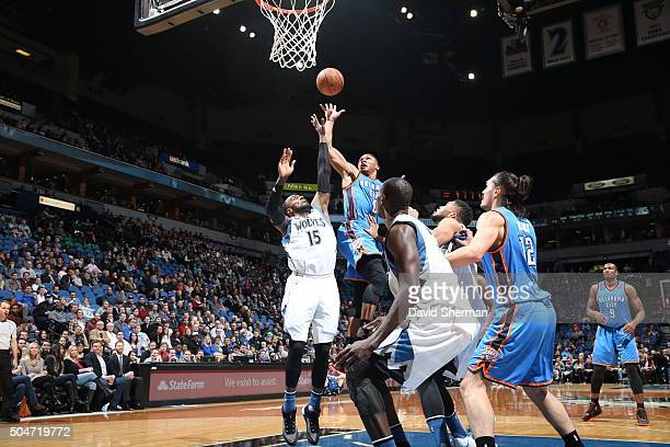 Russell Westbrook of the Oklahoma City Thunder goes to the basket against Shabazz Muhammad of the Minnesota Timberwolves on January 12 2016 at Target...