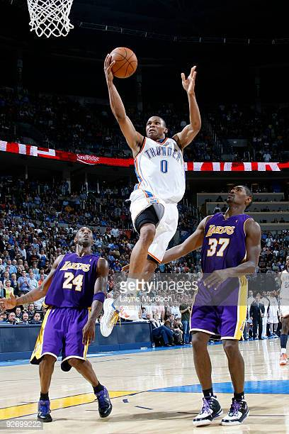 Russell Westbrook of the Oklahoma City Thunder goes to the basket against Kobe Bryan and Ron Artest of the Los Angeles Lakers on November 3 2009 at...