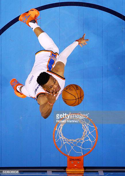 Russell Westbrook of the Oklahoma City Thunder goes up against the Golden State Warriors in the first half in game three of the Western Conference...