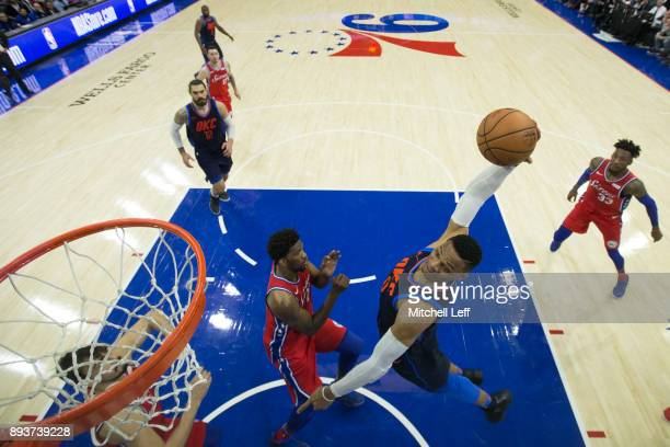 Russell Westbrook of the Oklahoma City Thunder goes up and misses the dunk against Joel Embiid of the Philadelphia 76ers in the fourth quarter at the...