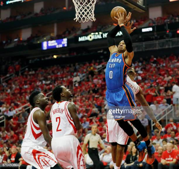 Russell Westbrook of the Oklahoma City Thunder goes up for a dund defended by Trevor Ariza of the Houston Rockets in the second half of Game Two of...
