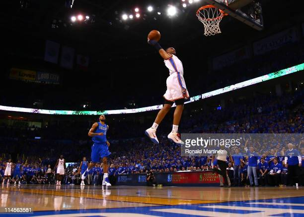 Russell Westbrook of the Oklahoma City Thunder goes up for a dunk in the first quarter while taking on the Dallas Mavericks in Game Four of the...