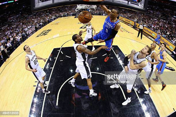 Russell Westbrook of the Oklahoma City Thunder goes up for a dunk in the first half against Kawhi Leonard of the San Antonio Spurs during Game Five...