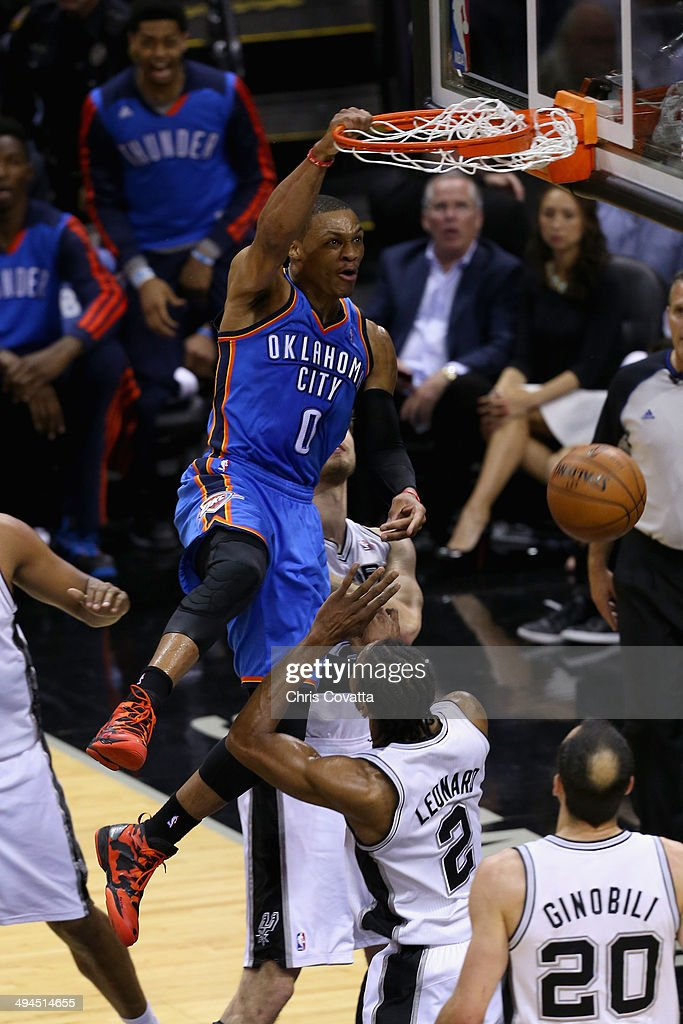 Russell Westbrook #0 of the Oklahoma City Thunder goes up for a dunk against Kawhi Leonard #2 of the San Antonio Spurs in the first quarter during Game Five of the Western Conference Finals of the 2014 NBA Playoffs at AT&T Center on May 29, 2014 in San Antonio, Texas.
