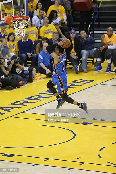 Russell Westbrook of the Oklahoma City Thunder goes up for a dunk against the Golden State Warriors in Game One of the Western Conference Finals...