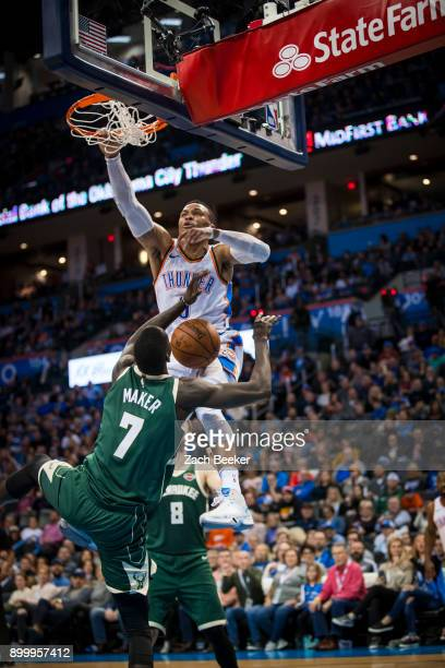 Russell Westbrook of the Oklahoma City Thunder goes up for a dunk against Thon Maker of the Milwaukee Bucks on December 29 2017 at Chesapeake Energy...