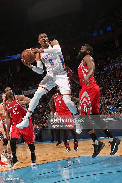 Russell Westbrook of the Oklahoma City Thunder goes up for a lay up against James Harden of the Houston Rockets on December 9 2016 at Chesapeake...