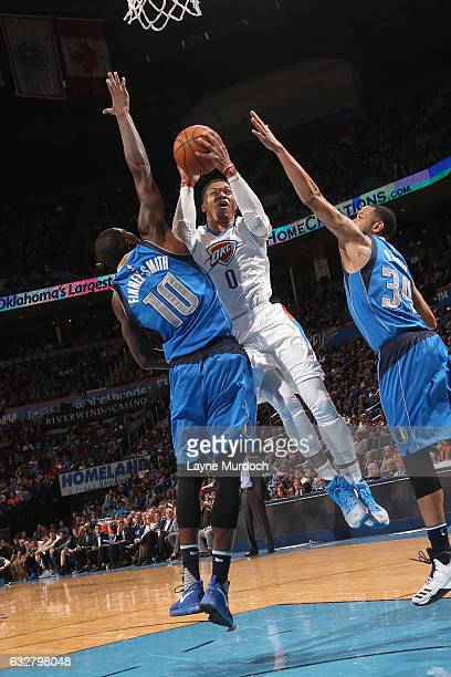 Russell Westbrook of the Oklahoma City Thunder goes up for a lay up against the Dallas Mavericks on January 26 2017 at Chesapeake Energy Arena in...