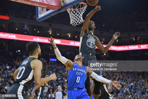 Russell Westbrook of the Oklahoma City Thunder goes up for a layup in front of Kevin Durant of the Golden State Warriors and gets fouled by Stephen...