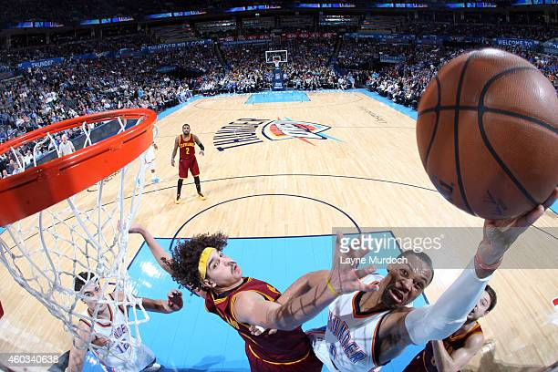 Russell Westbrook of the Oklahoma City Thunder goes up for a shot against the Cleveland Cavaliers at Chesapeake Energy Arena on December 11 2014 in...