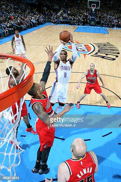 Russell Westbrook of the Oklahoma City Thunder goes up for a shot against the Portland Trail Blazers on December 23 2014 at Chesapeake Energy Arena...