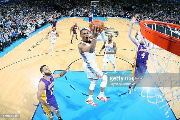 Russell Westbrook of the Oklahoma City Thunder goes up for a shot against the Los Angeles Lakers on March 13 2014 at the Chesapeake Energy Arena in...
