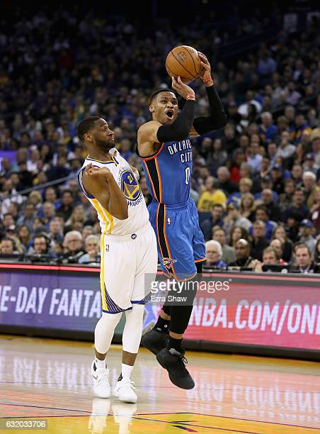 Russell Westbrook of the Oklahoma City Thunder goes up for a shot against Ian Clark of the Golden State Warriors at ORACLE Arena on January 18 2017...