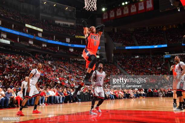 Russell Westbrook of the Oklahoma City Thunder goes up for the dunk against the Houston Rockets on March 26 2017 at the Toyota Center in Houston...