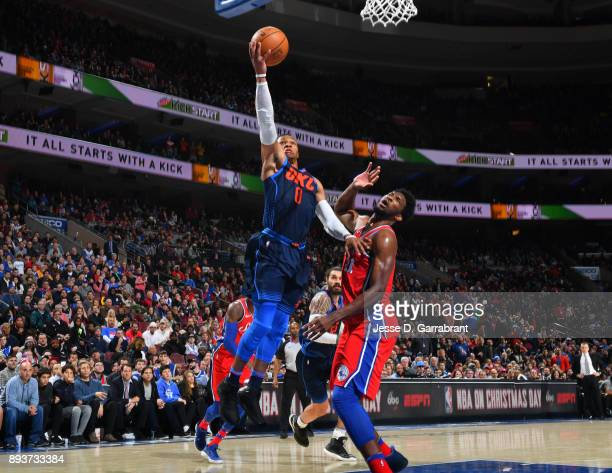 Russell Westbrook of the Oklahoma City Thunder goes up for the layup against the Philadelphia 76ers at Wells Fargo Center on December 15 2017 in...