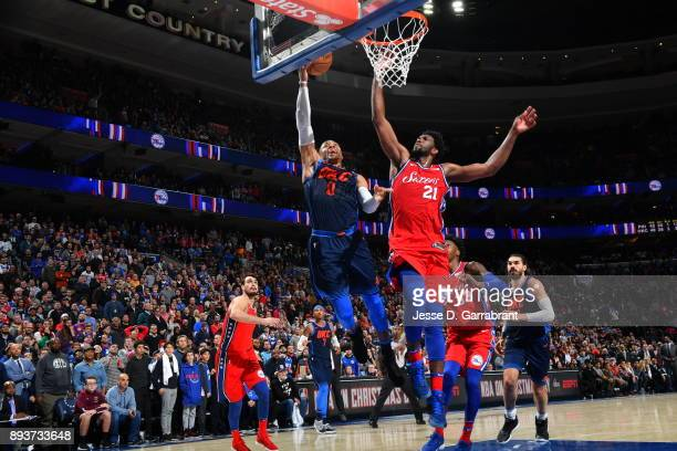 Russell Westbrook of the Oklahoma City Thunder goes up for the layup against Joel Embiid of the Philadelphia 76ers at Wells Fargo Center on December...