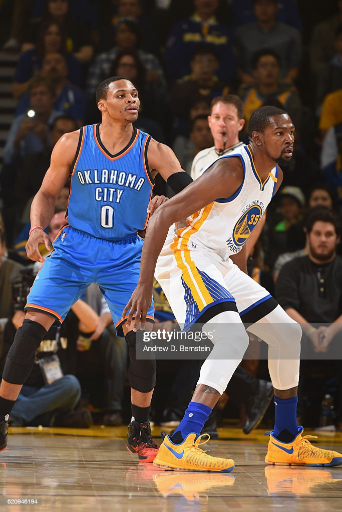 1fadfb09f256 Russell Westbrook of the Oklahoma City Thunder guards Kevin Durant ...