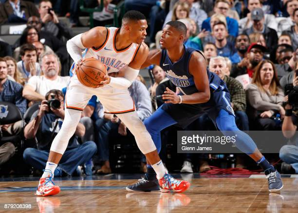 Russell Westbrook of the Oklahoma City Thunder handles the ball against Dennis Smith Jr #1 of the Dallas Mavericks on November 25 2017 at the...