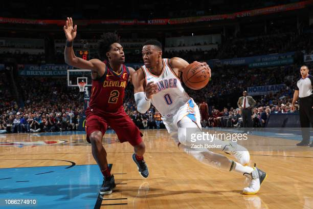 Russell Westbrook of the Oklahoma City Thunder handles the ball against Collin Sexton of the Cleveland Cavaliers on November 28 2018 at Chesapeake...