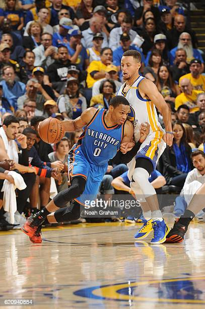 Russell Westbrook of the Oklahoma City Thunder handles the ball against Stephen Curry of the Golden State Warriors during a game on November 3 2016...
