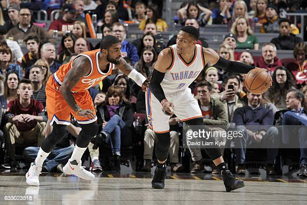 Russell Westbrook of the Oklahoma City Thunder handles the ball against Kyrie Irving of the Cleveland Cavaliers during the game on January 29 2017 at...