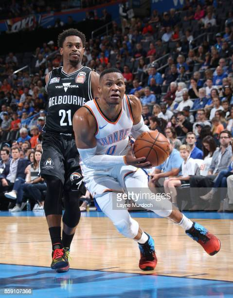 Russell Westbrook of the Oklahoma City Thunder handles the ball against Casper Ware of the Melbourne United during the preseason game on October 8...