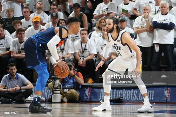 Russell Westbrook of the Oklahoma City Thunder handles the ball against Ricky Rubio of the Utah Jazz in Game Four of Round One of the 2018 NBA...