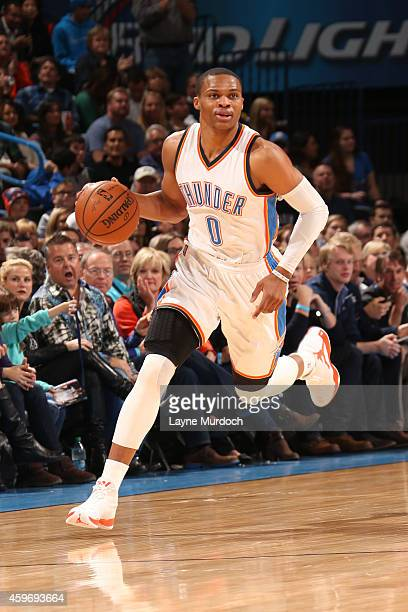 Russell Westbrook of the Oklahoma City Thunder handles the ball against the New York Knicks on November 28 2014 in Oklahoma City Oklahoma NOTE TO...