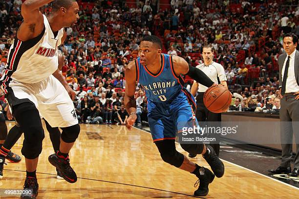 Russell Westbrook of the Oklahoma City Thunder handles the ball against the Miami Heat on December 3 2015 at AmericanAirlines Arena in Miami Florida...