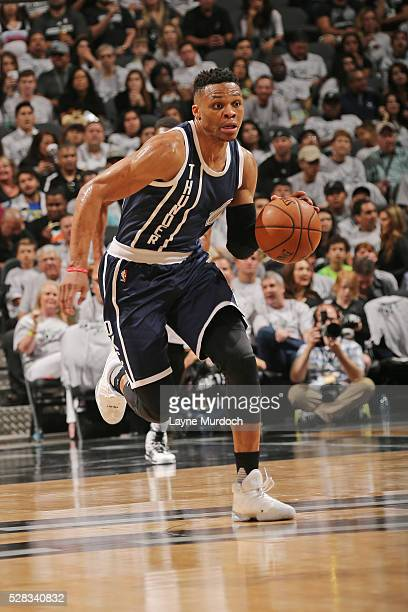 Russell Westbrook of the Oklahoma City Thunder handles the ball against the San Antonio Spurs in Game One of the Western Conference Semifinals during...